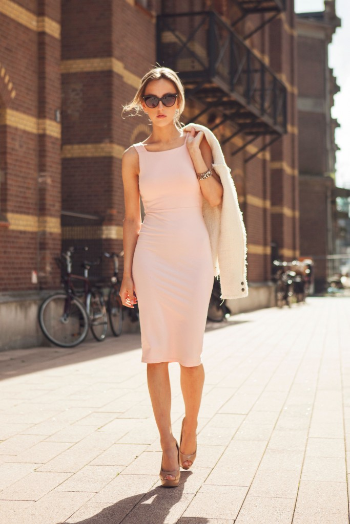 Anna Belle is wearing an Asos blush pink bodycon dress