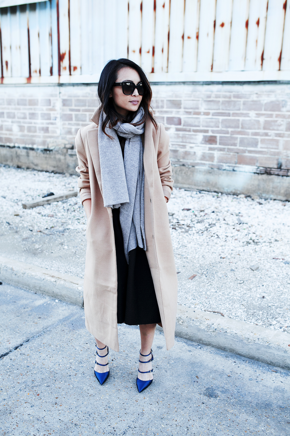 A cashmere scarf is the ultimate accessory to a maxi coat. Try paler colours on yours when wearing a beige coat, like the one seen here worn by Juley Le. Coat: Forever 21, Scarf: Autumn Cashmere.