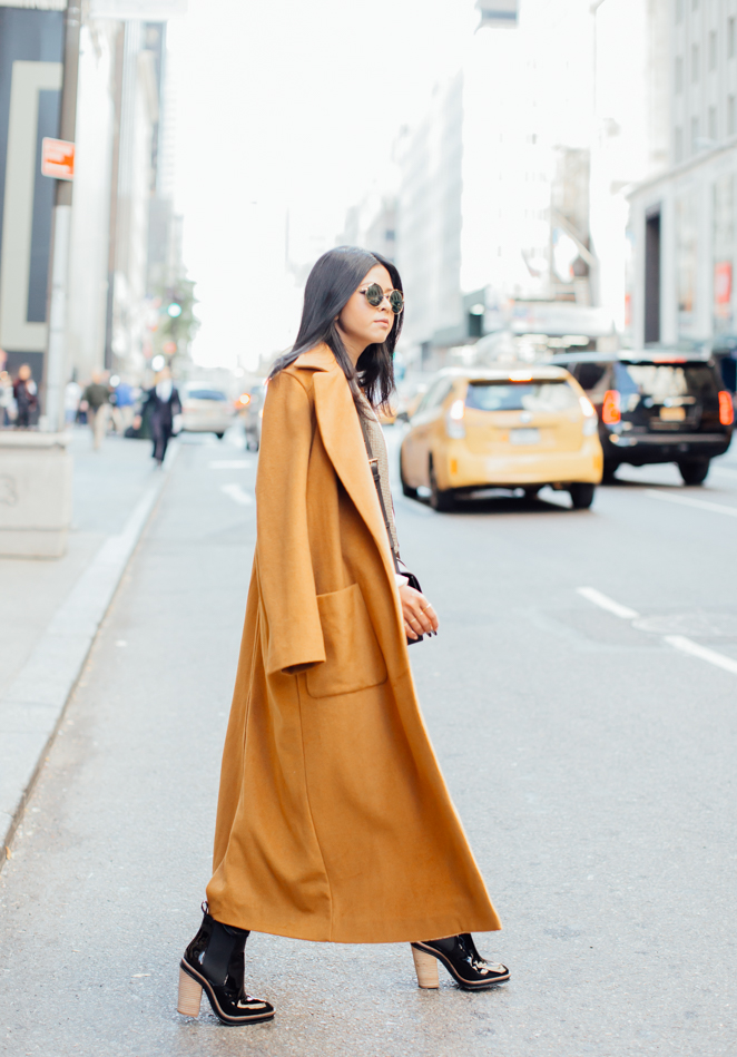 Dare to wear the mustard yellow this season! Perfect for autumn and winter hues, this mustard maxi coat is cosy, warm and effortlessly stylish. Via Sheryl Luke. Coat: C/Meo Collective, Top/ Jeans: L'Agence, Shoes: Aldo, Vest: Zara, Bag: YSL.