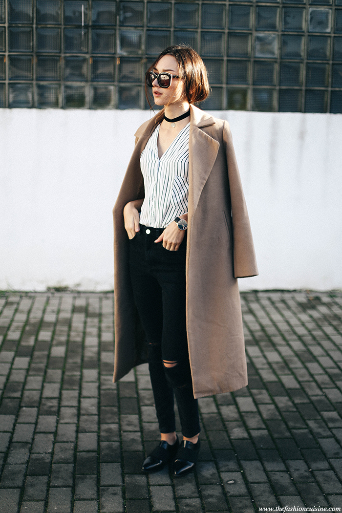Wearing classic loafers with your maxi coat can make for an ultra chic, retro style. Beatrice Gutu wears this Shoeshibar pair with ripped black denim jeans and a striped shirt, accessorised with a funky choker and shades. Coat: Missguided, Shirt: Chace, Jeans: Asos, Shoes: Shoeshibar.