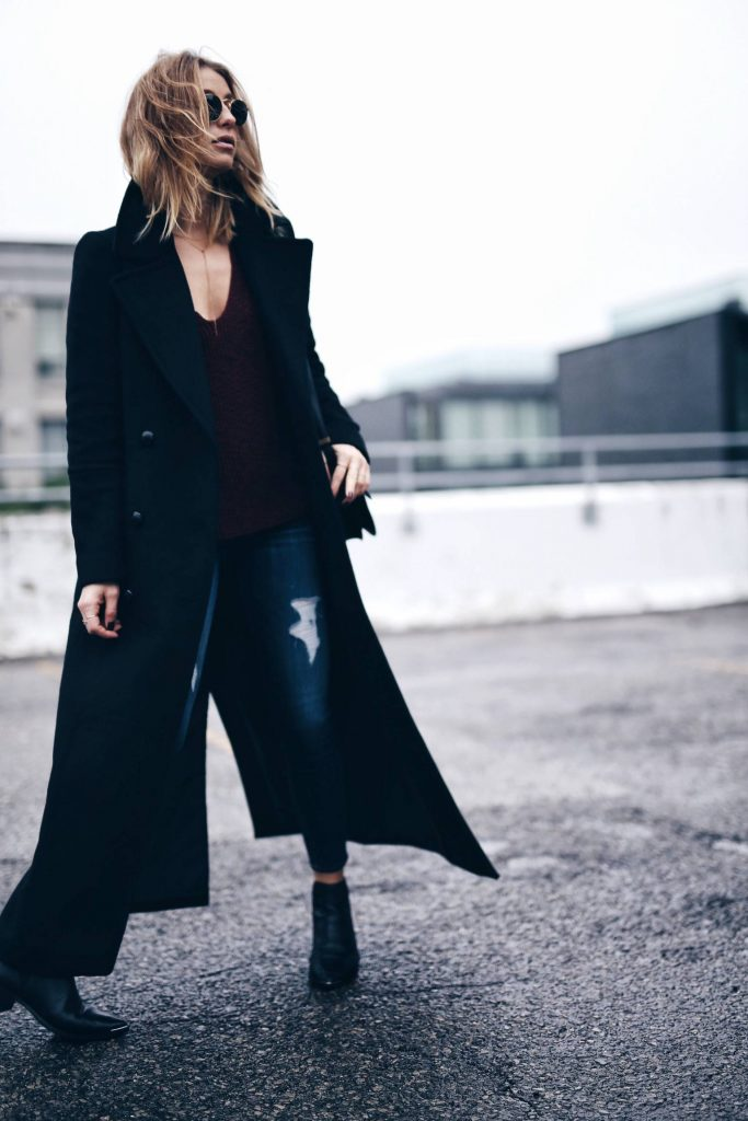 Maxi coats are making a definite return to fashion this fall! Jill Lansky is wearing a stylish black coat with jeans and booties, making for an elegant yet casual style. Sweater/Jeans: Express, Boots: Acne.