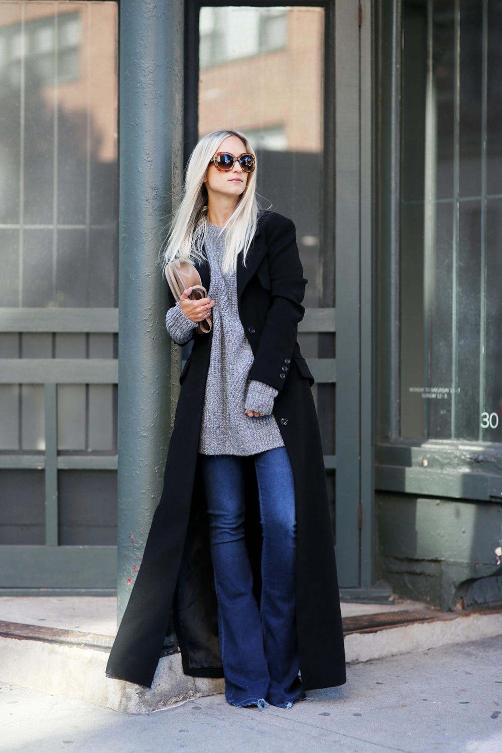 Dare to go all out in a floor length maxi coat this winter! Charlotte Groeneveld rocks this gorgeous black coat, wearing it over casual knitwear and a pair of flared denim jeans; a stylish and feminine look. Coat: Karen Millen, Knit: &Other Stories, Jeans: True Religion.