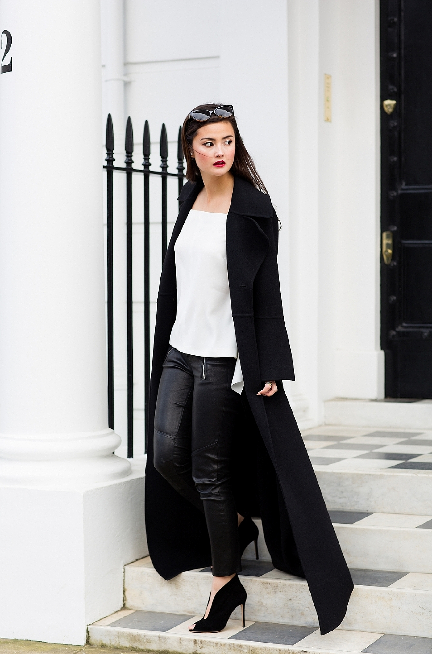 Peony Lim wears the maxi coat trend with leather leggings and a gorgeously simplistic white top to create an elegant and smart overall look. Worn with heels, this look is also ultra glamorous. Coat: Celine, Top: Pinko, Trousers: J. Brand, Shoes: Gianvito Rossi, Bag: Charles and Keith.