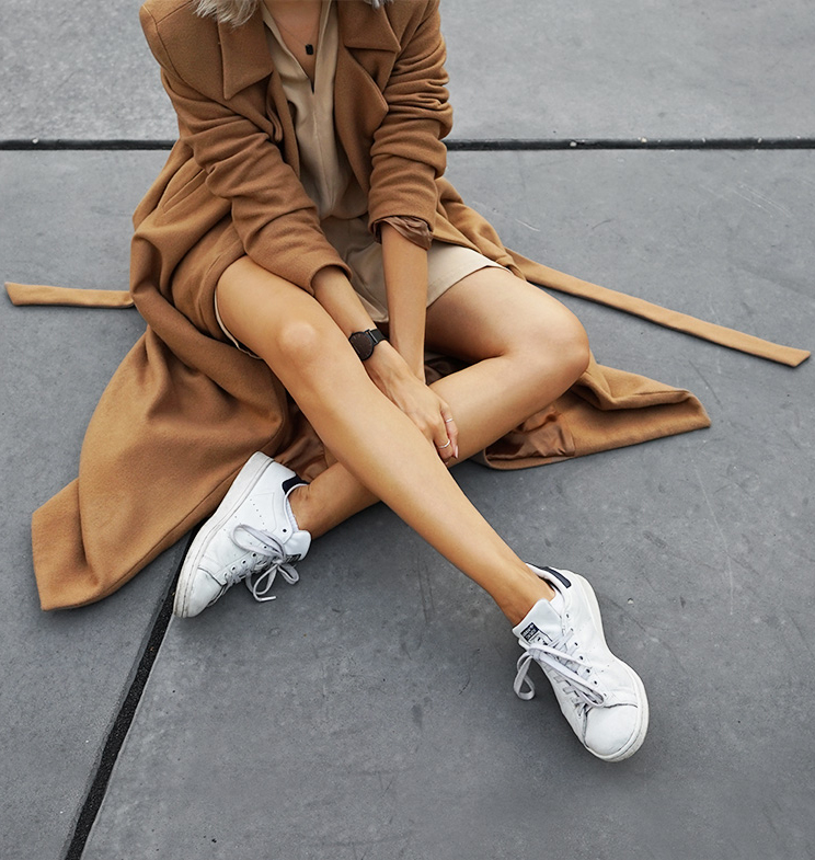 Camel and beige tones and a pair of white sneakers. Via Joyce Croonen  Coat: Charlie May, Dress: Marina London, Sneakers: Adidas Stan Smith