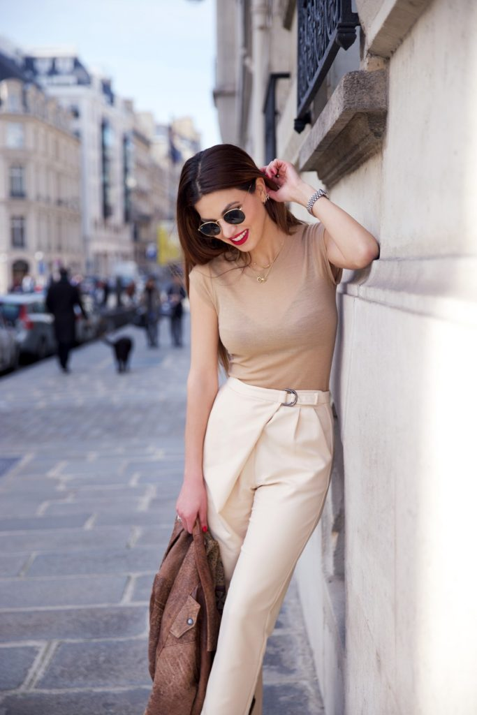 Negin Mirsalehi is wearing a camel slim merino T-shirt from Filippa K and beige peg leg trousers