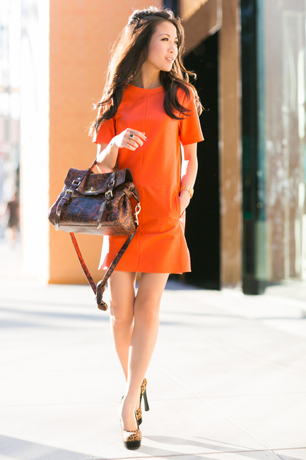 Wendy Nguyen is looking strikingly confident in this vibrant orange tshirt dress, paired with eye catching leopard print heels and a matching bag! We recommend this look if you really want to try something new! Dress: Vince, Bag: Mulberry, Shoes: YSL.