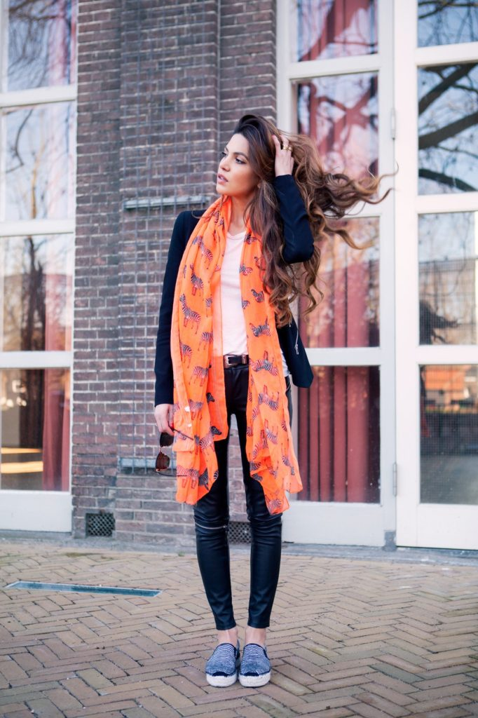 Orange Outfits: Negin Mirsalehi is wearing an orange scarf with zebra print from Bershka