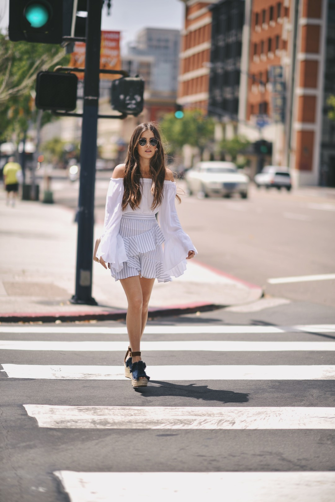 Platform shoes like these are a must have to wear with your most striking summer outfits! Paola Alberdi wears this pair of navy platforms with a gorgeous striped poplin skirt and a bell sleeved blouse. Skirt/Shoes: Luisaviaroma.