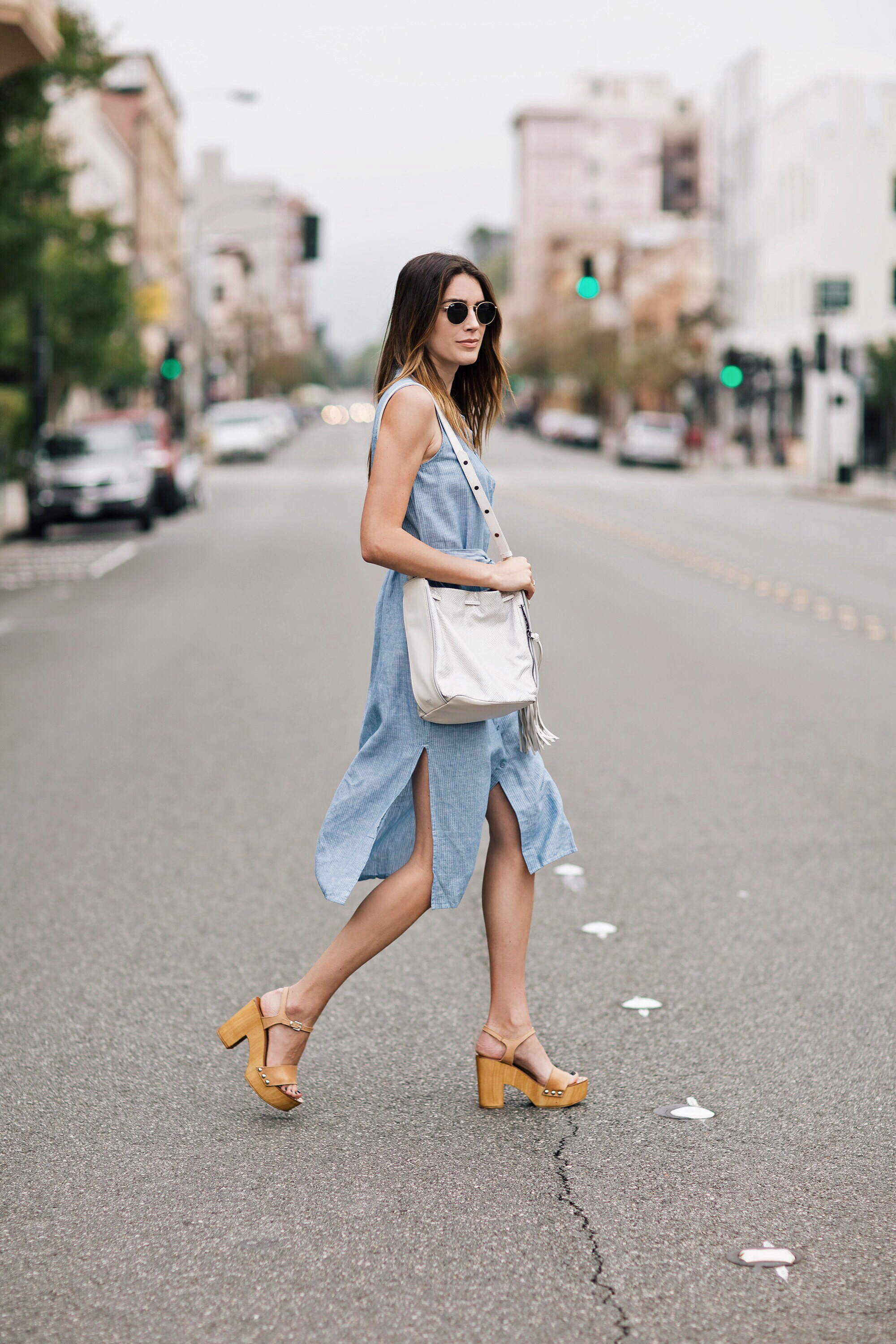 It's summer dress season! This super cute pastel blue piece with slit detailing from Sanctuary Clothing is the perfect choice for a warm summer's day. Brittany Xavier wears this look with chunky platforms, the ultimate match! Dress: Sanctuary Clothing, Sandals: Steve Madden, Bag: Botkier.