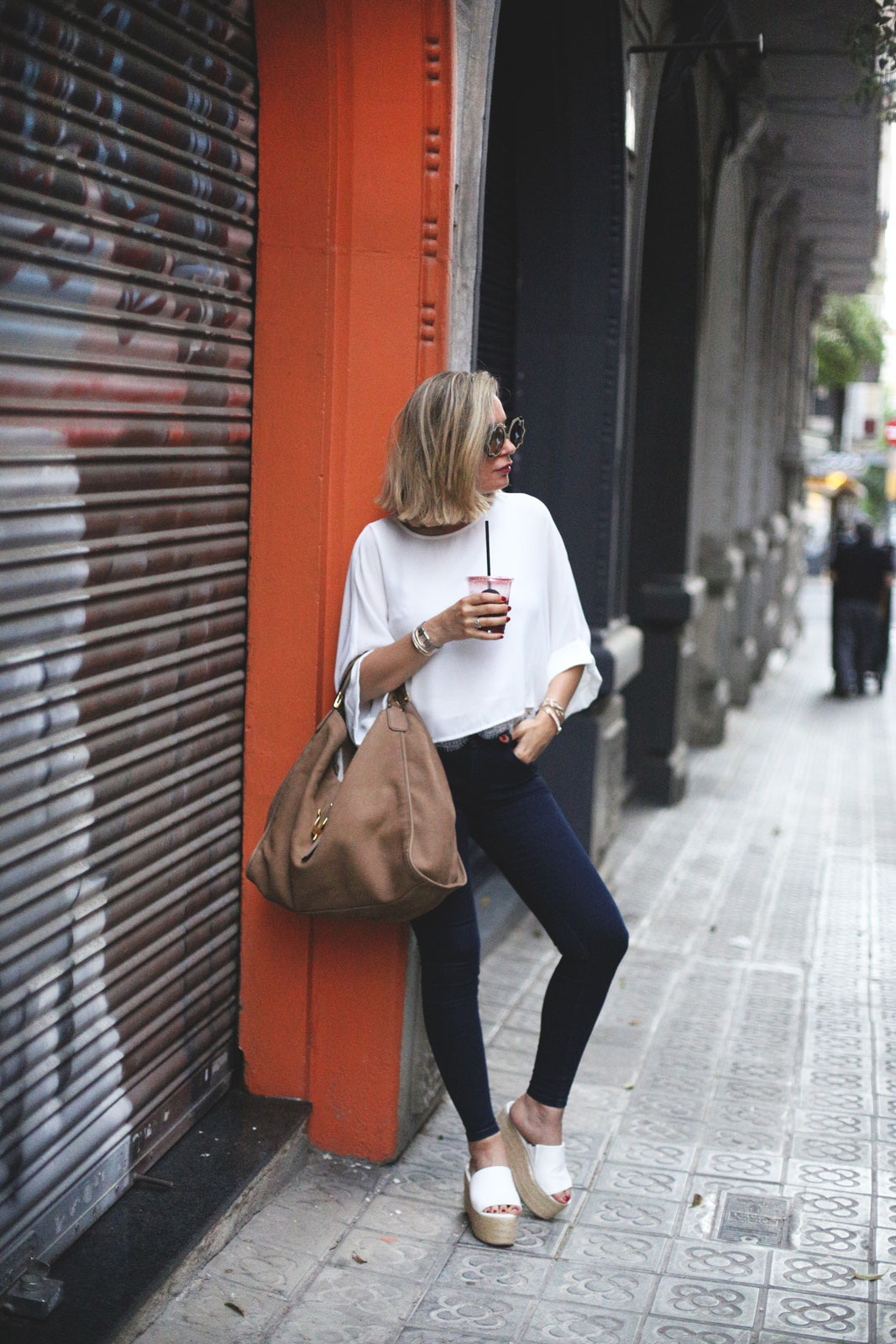 Priscila Betancort is rocking a hot summer style in these glorious white platform sandals, which add glamour and sexiness to an otherwise fairly casual look. You really can wear sandals such as these with anything; they're perfect with jeans or a summer dress! Top: Oxygene, Bag: Gucci, Jeans: Pepe Jeans, Wedges: Asos.
