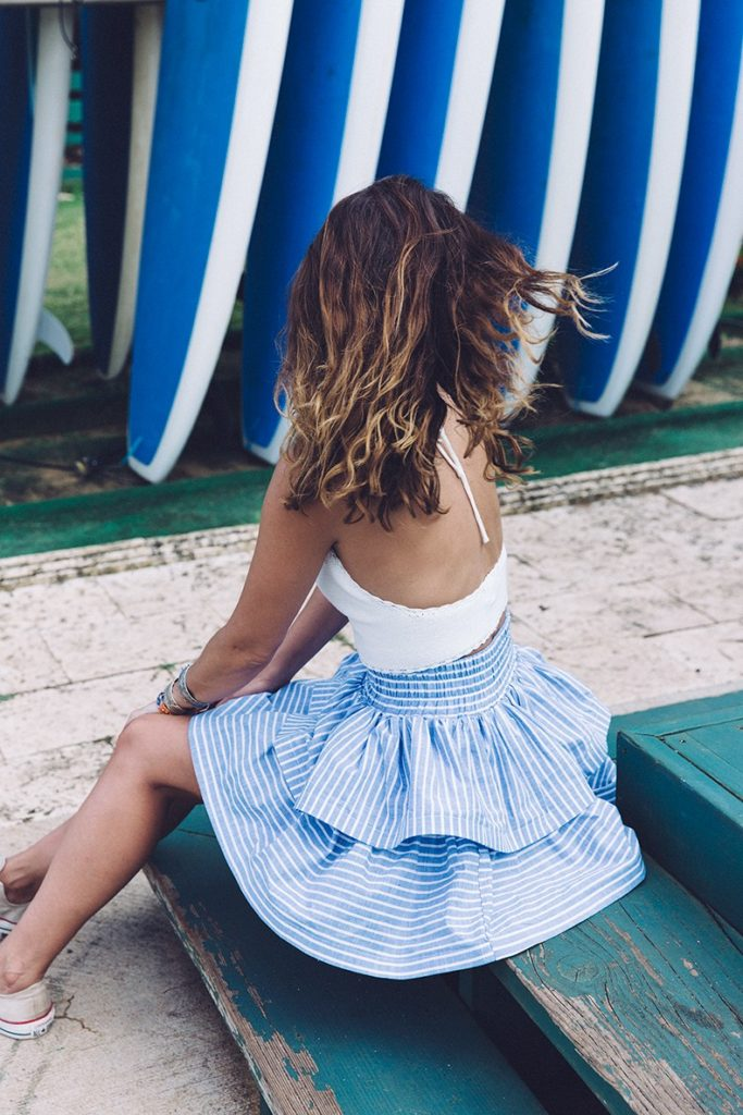 Styling A Striped Skirt: Sara Escudero is wearing a baby blue and white pinstripe Asos skirt