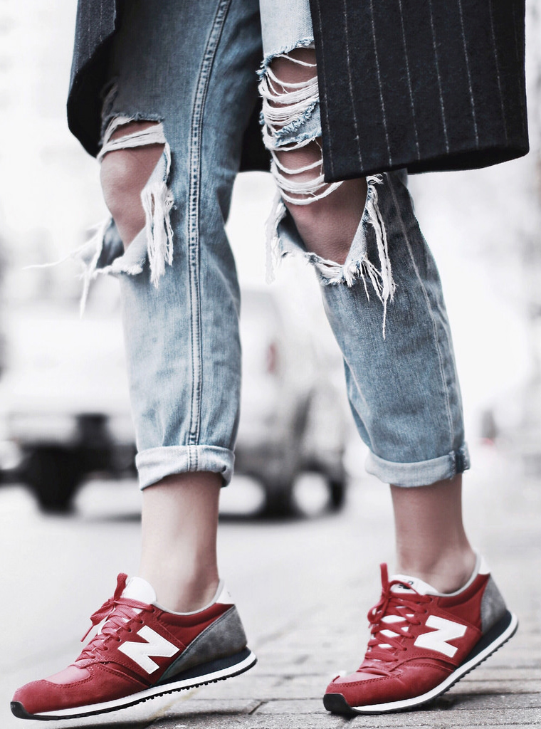 Street Style March, 2015: Mary Seng is wearing ripped jeans from TopShop and the red sneakers are from New Balance