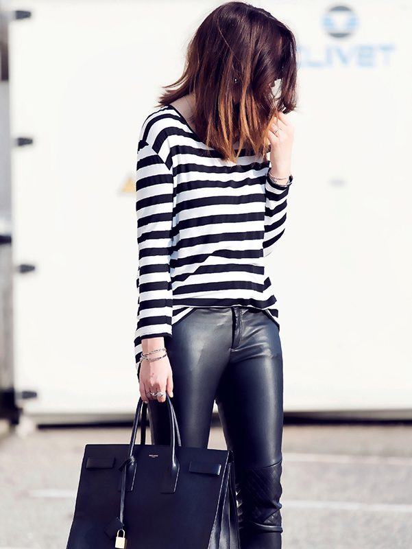Nicoletta Reggio is wearing a black and white striped long sleeved top from Mango