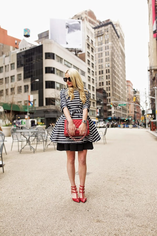 Blair Eadie is wearing a blue and white striped dress from Tibi