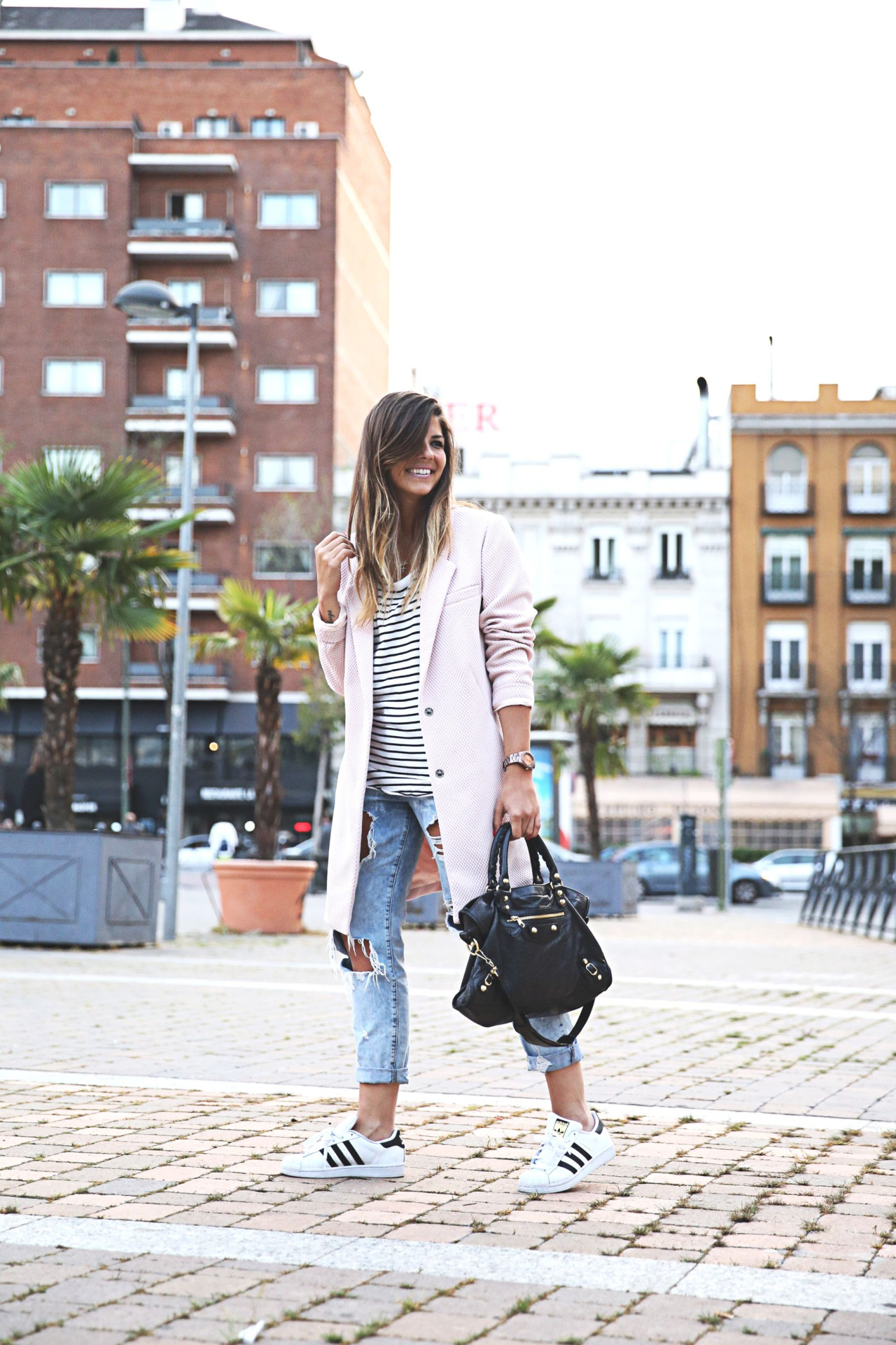 Natalia Cabezas is wearing a blue and white striped T-shirt from Zara