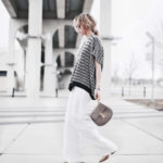 Wide Leg Pants Trend: Mary Seng is wearing white high rise wide leg pants from Chelsea28