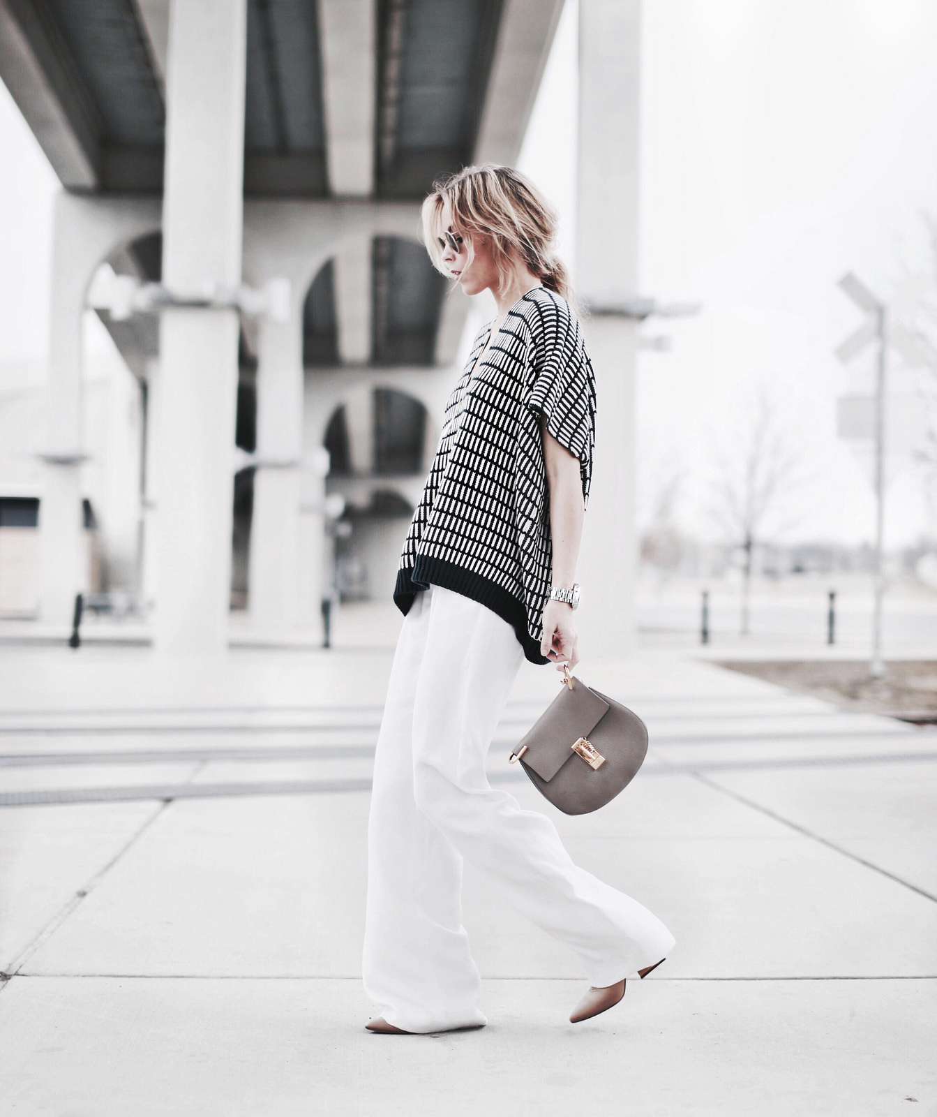 02bd1a24d3a5 Wide Leg Pants Trend  Mary Seng is wearing white high rise wide leg pants  from