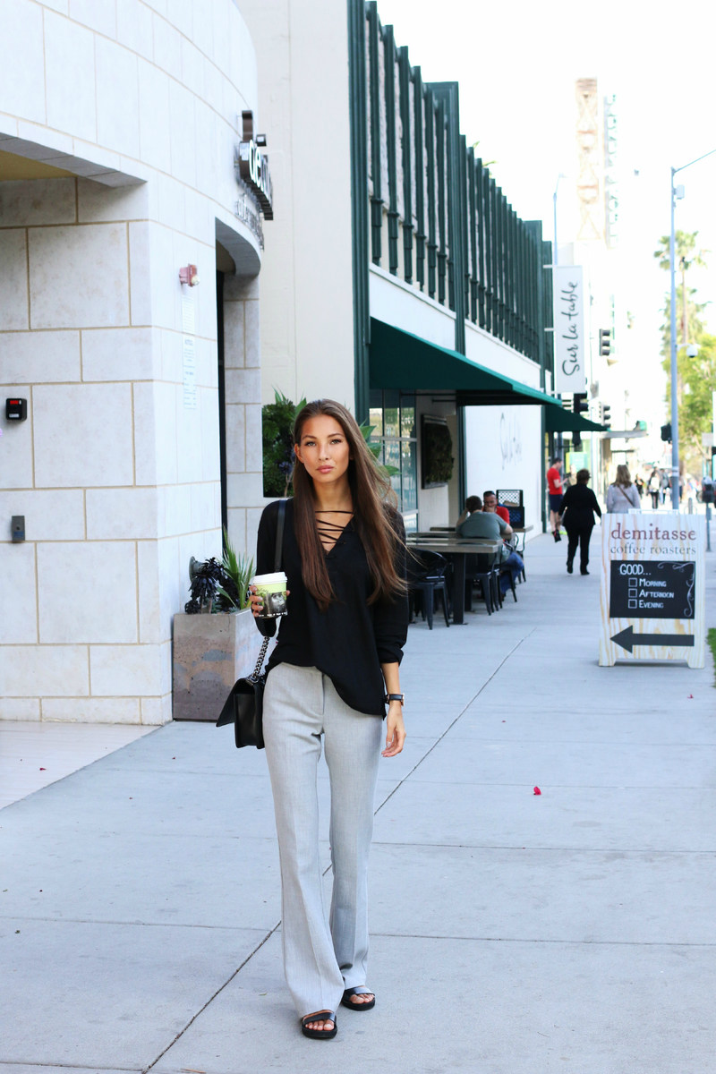 Wide Leg Trouser Trend: Felicia Akerstrom is wearing a pair of pale grey Topshop trousers