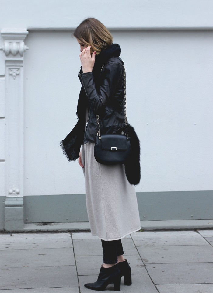Long Over Long Fashion Trend: Marie Danker is wearing an Ava Cashmere knit vest over a pair of black Asos jeans