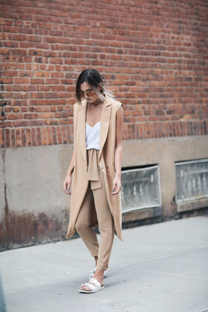 Danielle Bernstein is showing off the neutral trend with a beige pair of Zara trousers, a Cameo The Label vest and a white Equipment cami