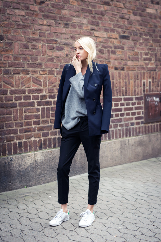 Street Style 2015: Ellen Claesson is wearing a navy blue blazer and black trousers from Zara with a COS grey sweater and Stan Smith sneakers