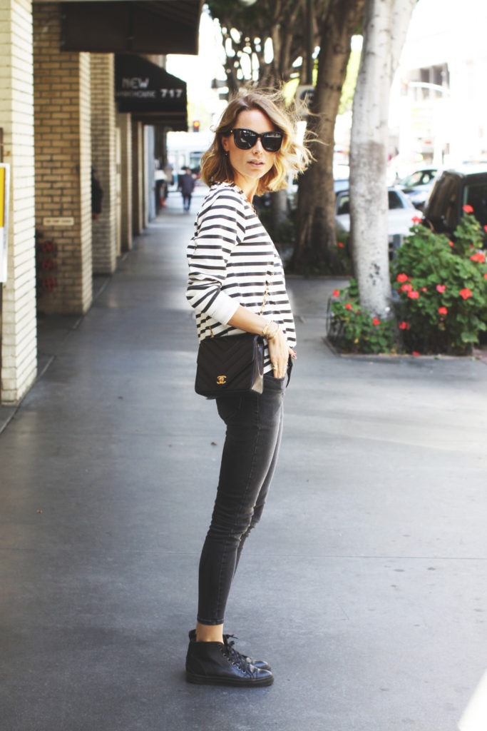 Black & White Striped Outfits: Anine Bing is wearing a striped sweatshirt from Anine Bing