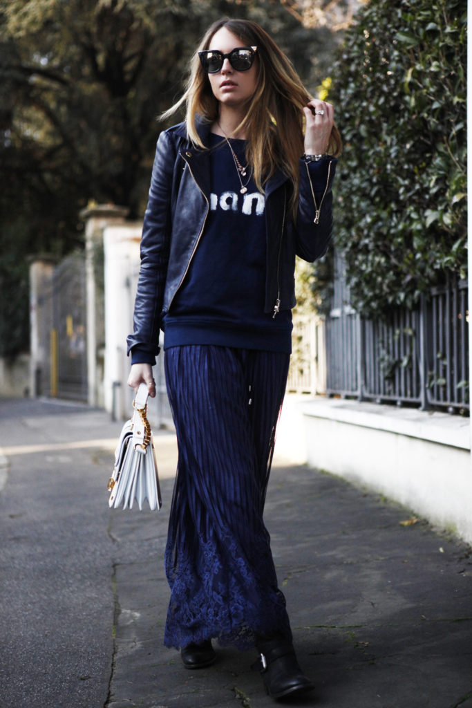 Street Style, March 2015: Virginia Varinelli is wearing a navy blue maxi skirt from Twisted with a Chanel sweater and a Twinset leather jacket