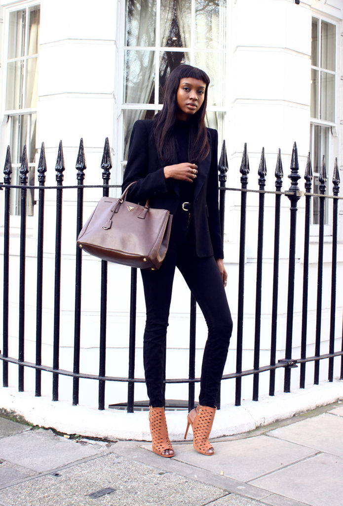 Street Style, March 2015: Natasha Ndlovu is wearing a black Zara blazer with an Asos turtleneck, American Apparel jeans and Missguided camel heels