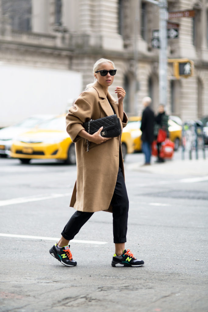 Street Style, March 2015: Lisa Olsson is wearing a camel Asos coat with black Hope trousers and New Balance sneakers
