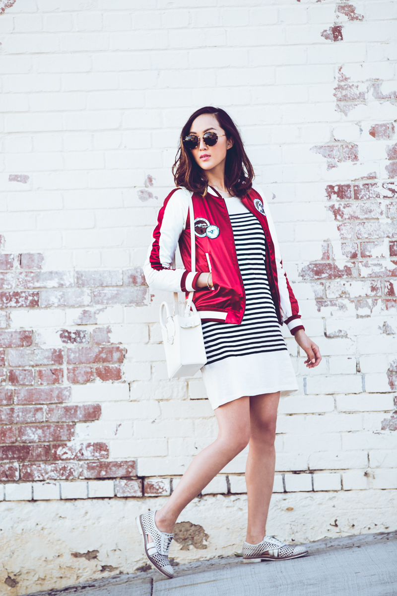 Black And White Pinstripe Dresses: Chriselle Lim is wearing a Joie mid length pinstripe dress