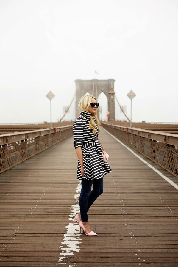 Dresses Over Pants: Blair Eadie is wearing a black and white striped Valentino dress over a pair of denim Elliot jeans