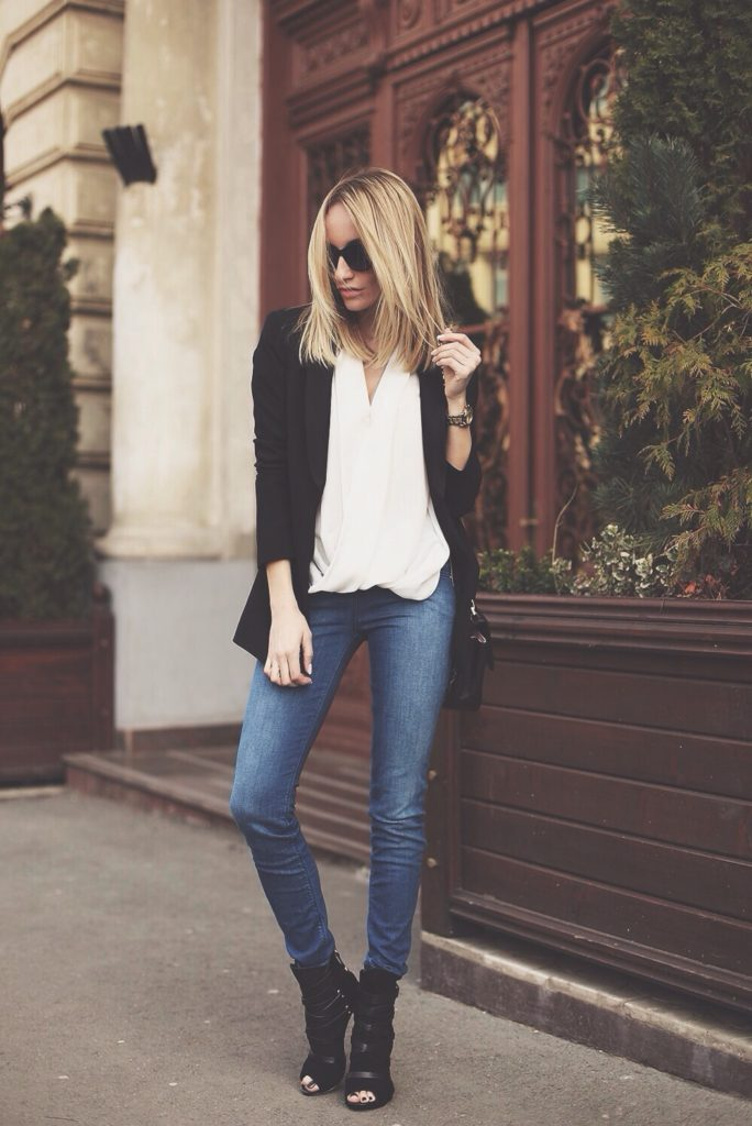 Street Style, March 2015: Silvia Postolatiev is wearing a black blazer, denim skinny jeans and ankle boots all from Guess