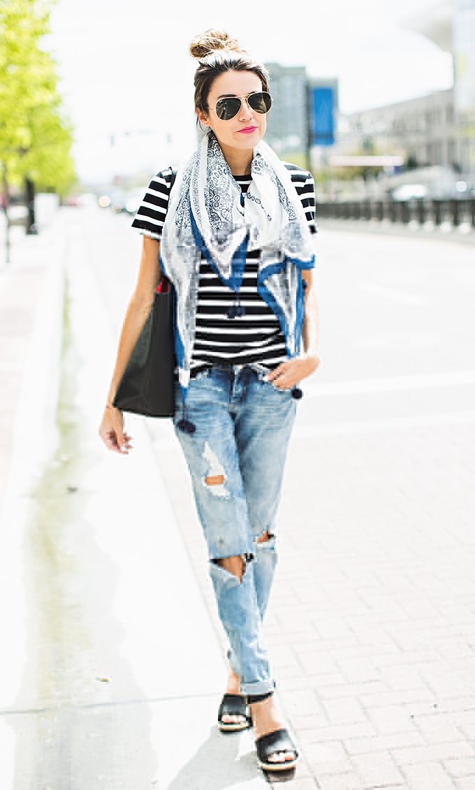 Striped Outfits & Ideas: Christine Andrew is wearing a black and white pinstripe Old Navy tee