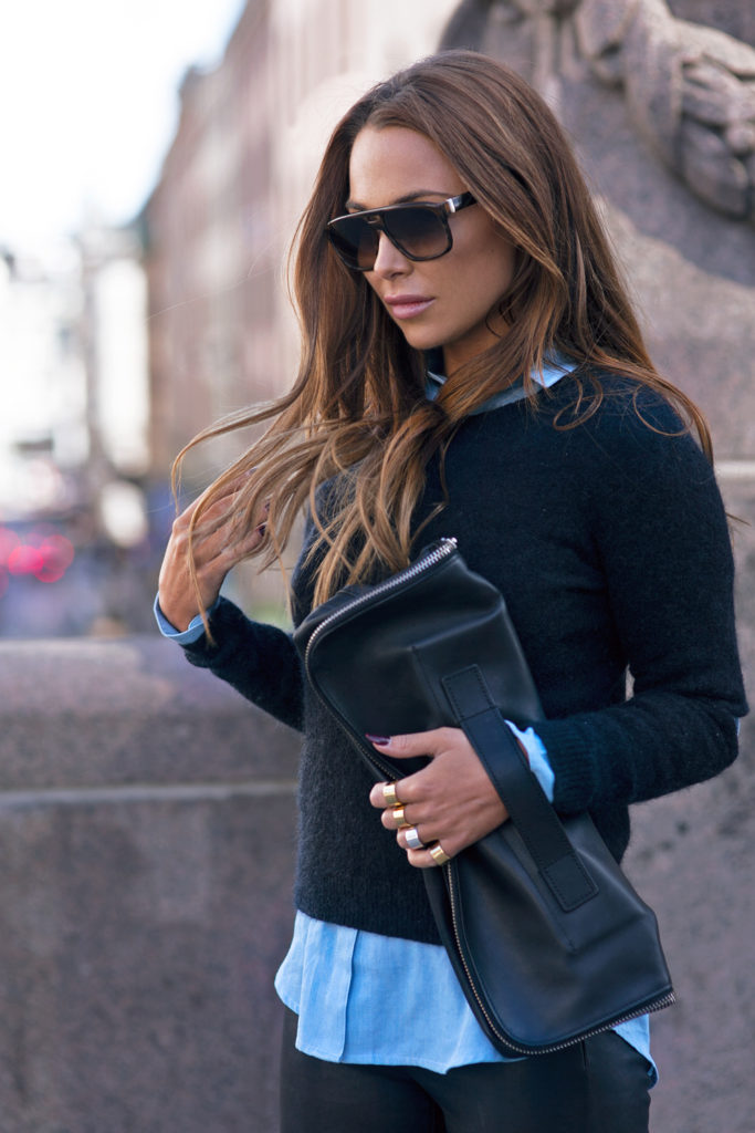 Black And Blue Casual Outfits: Johanna Olsson is wearing a baby blue By Malina shirt under a Won Hundred sweater paired with a black 3.1 Phillip Lim fillip Lim clutch bag