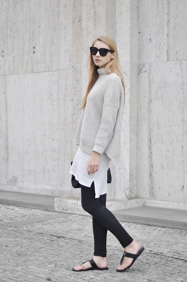 Dress Over Pants: Pavlina Jagrova is wearing a white Zara dress with black Topshop skinny jeans