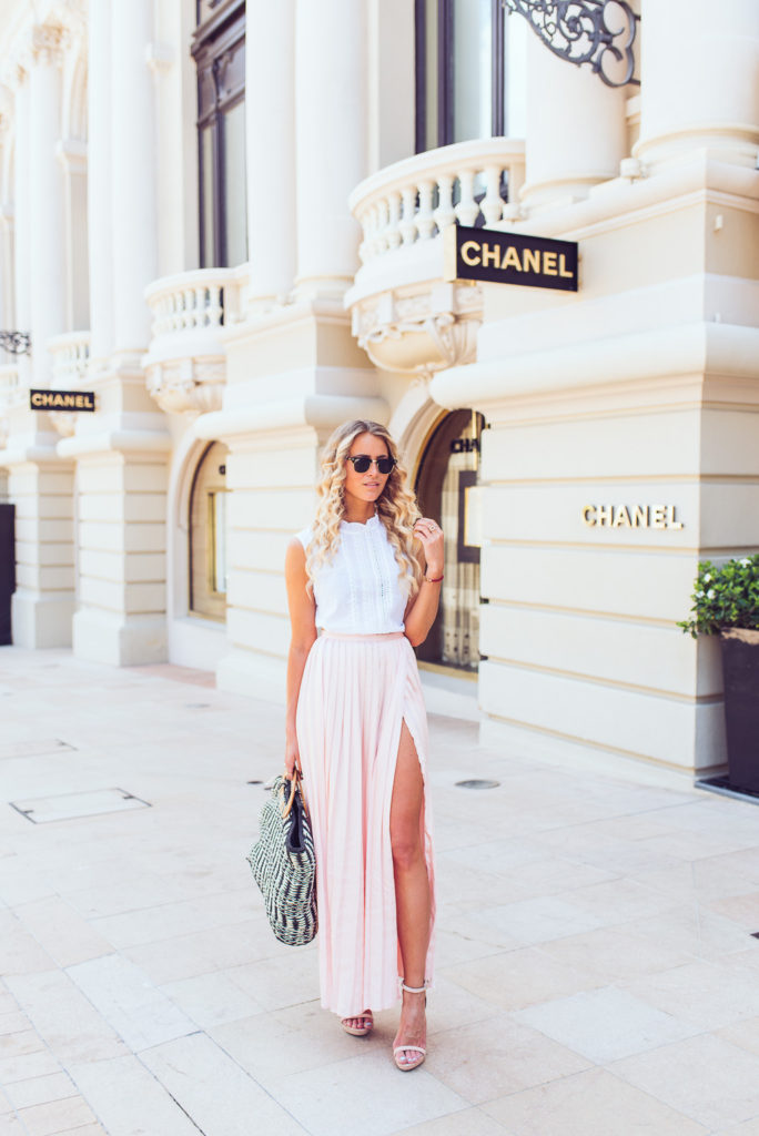 Janni Deler is wearing a pastel pink Make Way pleated maxi skirt with a high slit