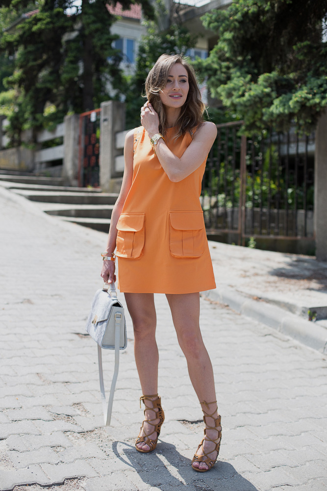 Ioana Chisiu in a tangerine orange Moja dress