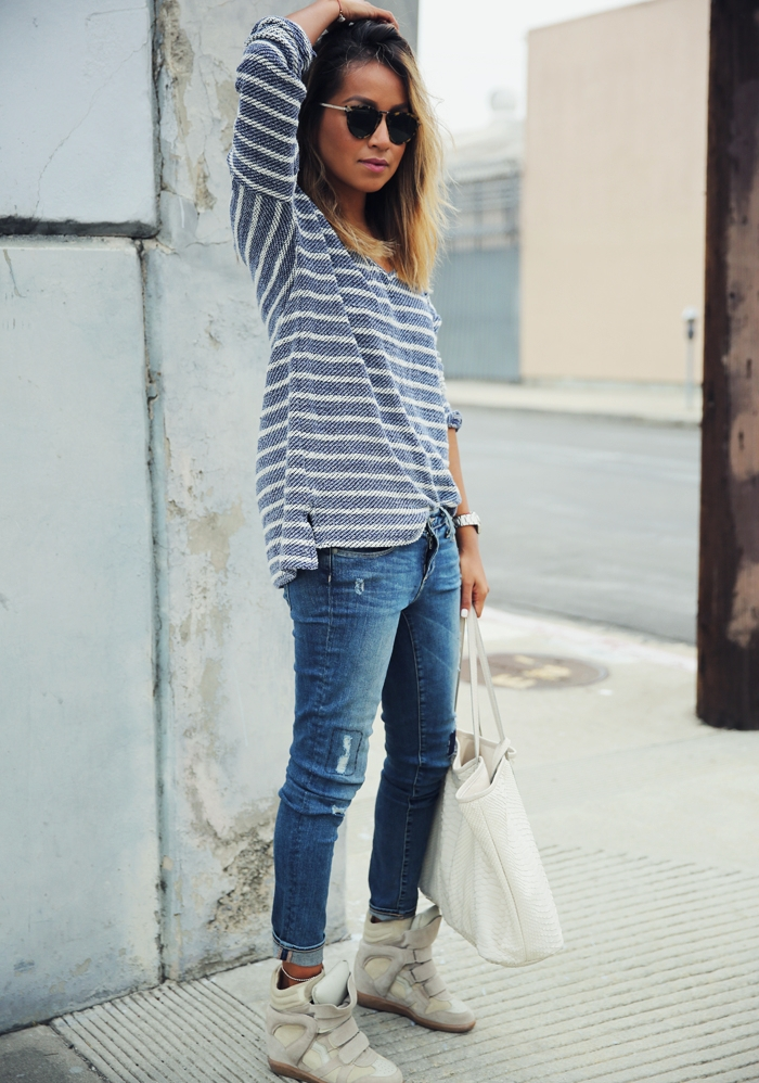 Julie Sarinana is wearing a Paige long sleeved striped top