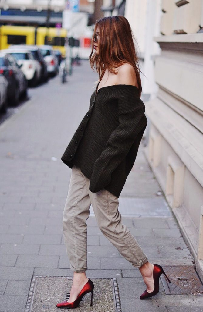 Street Style, March 2015: Maja Wyh is wearing an oversized Rochas cardigan with a pair of grey Closed trousers red Sergio Rossi heels