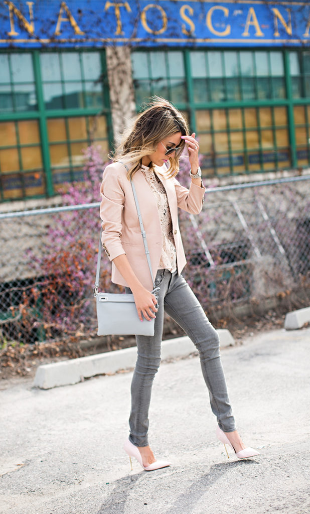 Christine Andrew is wearing a blush pink blazer with a pair of Kurt Geiger heels