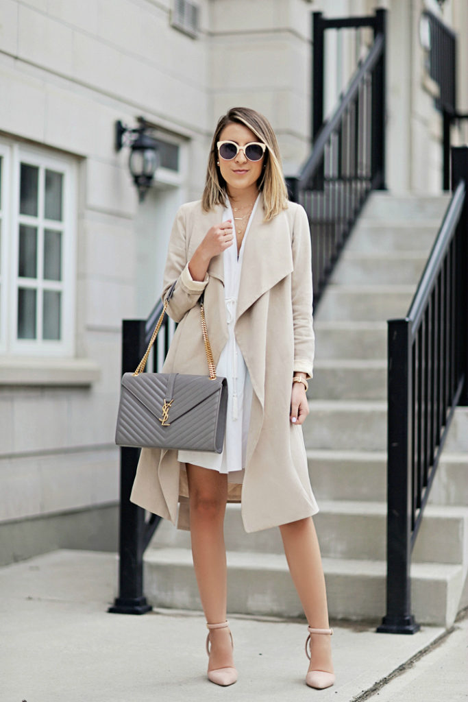 Neutral Outfits & Ideas: Stephanie Sterjovski is wearing a beige Club Monaco trench coat with a creme Aritzia dress and 424 Fifth pink heels