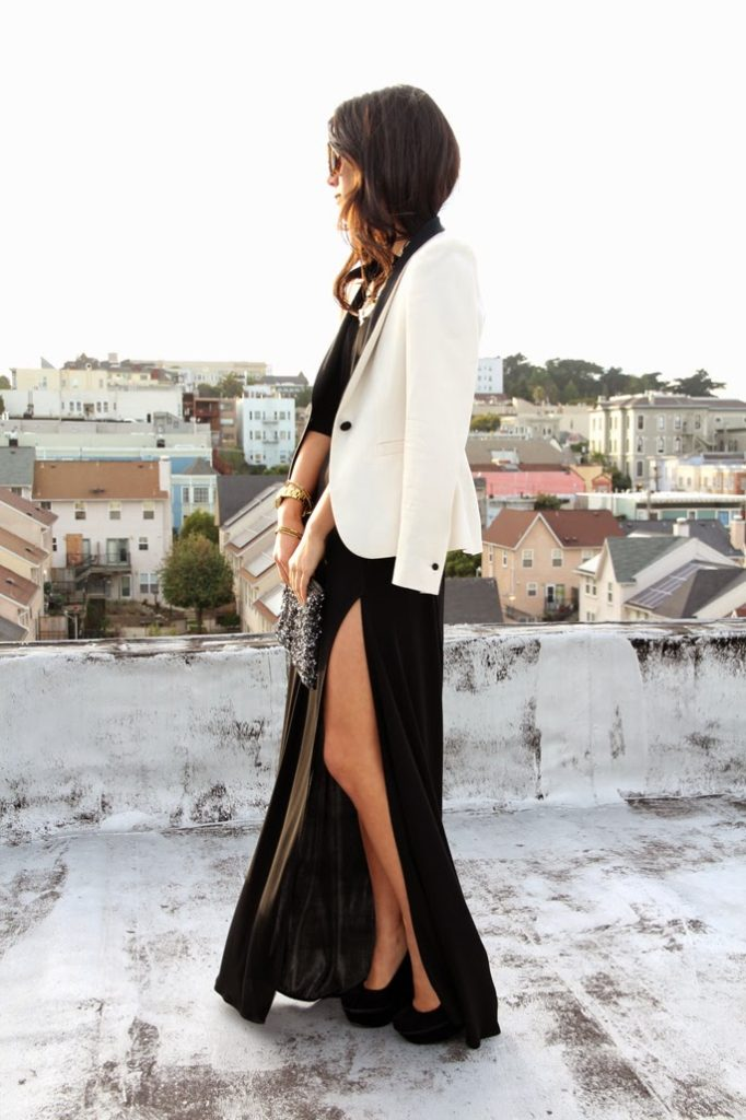 Skirt With A Thigh High Slit: Krystal Bick is wearing a satin black maxi skirt with a thigh high slit