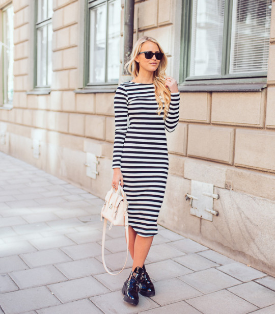 Janni Deler is in a black and white striped maxi dress ready for spring Dress: Lindex