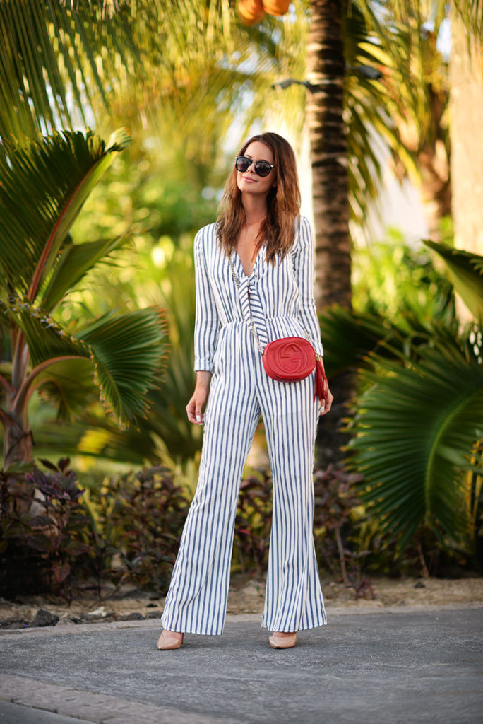 Annette Haga is wearing a white and navy Striped Nasty Gal playsuit