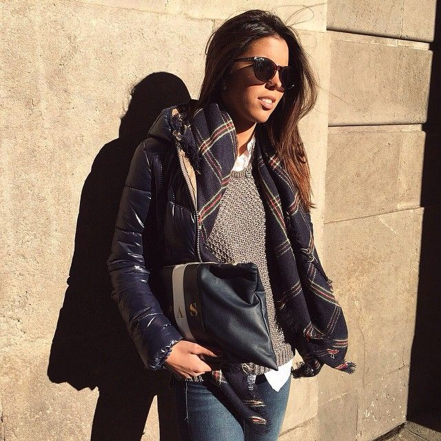 Best of Instagram Fashion: @pau_amezaga is wearing a navy puffa jacket with a plaid scarf, grey knitted sweater and denim skinny jeans