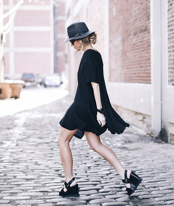 Mary is wearing a black French Connection mini dress with pair of Marc Jacobs wedges