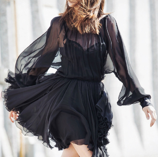 Just The Design: Nicoletta Reggio is wearing a black long sleeved chiffon Dolce & Gabbana dress