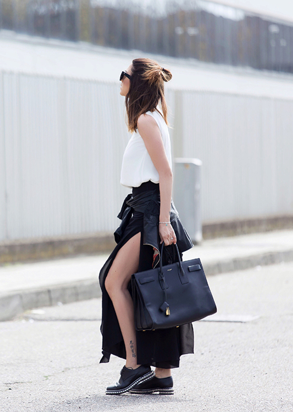 Nicoletta Reggio is wearing black chiffon Giorgia&Johns high slit pants