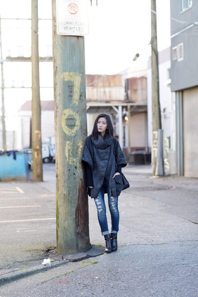 Just The Design: Claire Lui is wearing a pair of denim skinny jeans from Wellbinder, a grey Sheinside loose coat and a pair of black boots