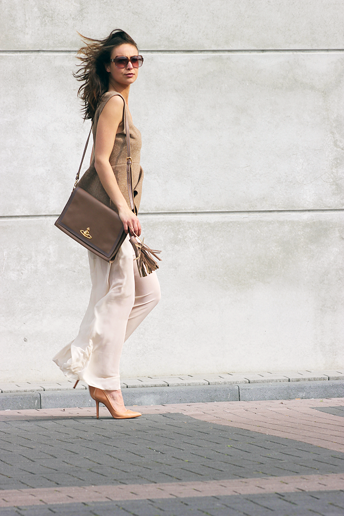 Casual Wide Leg Trousers: Annemiek Kessels is wearing a pair of sheer creme COS trousers